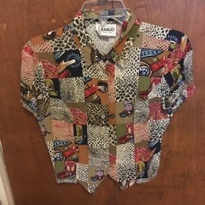 Vintage cowboy boot and snakeskin button up shirt